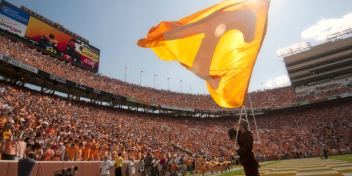 Davy Crockett waving the orange Power T flag at home football game
